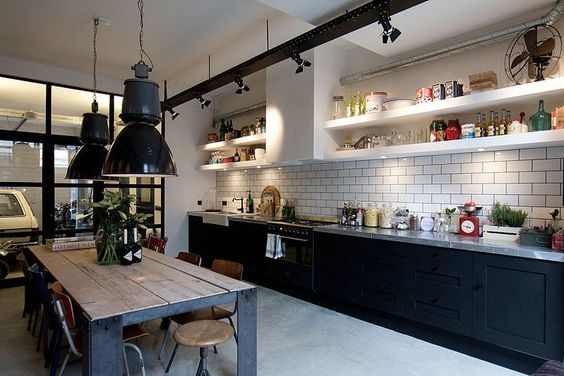 Designed by Bricks Amsterdam, this eclectic garage loft is located in Amsterdam, Netherlands