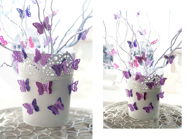 Поставьте в кашпо веточки красивой формы. Украсьте их маленькими бумажными бабочками.
