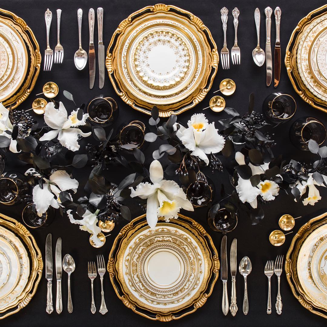 Florentine Chargers in Black/Gold + Crown Gold Collection Vintage China + Antique Silver Flatware + Bella 24k Gold Rimmed Stemless Glassware in Smoke